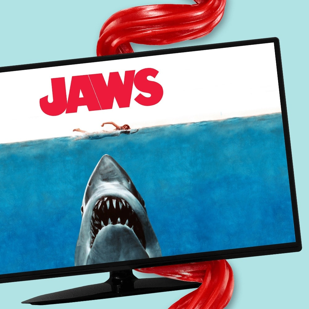 Shark on TV in front of Twizzlers Candy