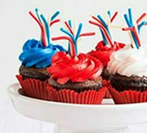 cupcakes with red, white, and blue icing, and pull 'n peel twizzlers on top